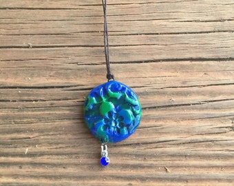 Blue-green flower pendant