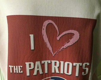 I love the Patriots printed on a Pink Tshirt by #dbcoverzzz