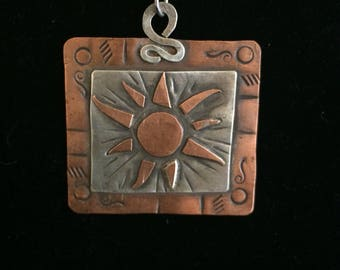 Sterling and copper sun pendant