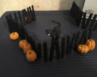 Department 56 Halloween Black Picket Fence (two pieces) with Cat and Pumpkins