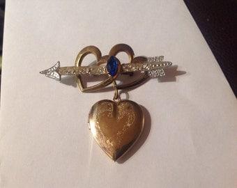 Heart locket brooch with cupids arrow through hearts