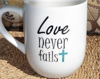 Love never fails coffee cup, Christian mug