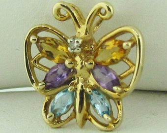 Yellow gold multi stone butterfly pendant. Vintage.