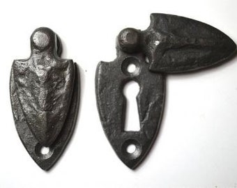 A pair of beaten cast iron Gothic shield door keyhole escutcheon church CR3