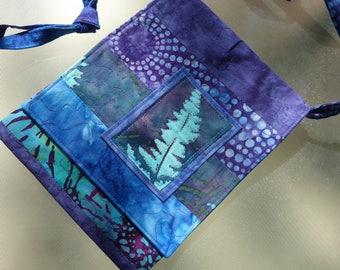 New: Mini batik quilted bag. This small batik bag has plenty of space for phones, passports, travel.
