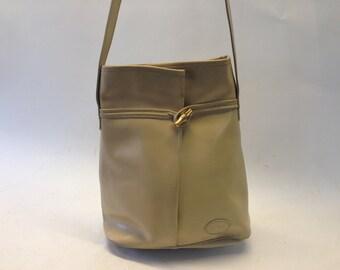 Longchamp | Vintage | Sac à main | 1980s | Cuir | Crème | Bouton roseau | Forme trianglulaire | Sac Bandoulière