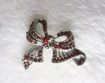 Pewter Bow Brooch - embellished with ruby red rhinestones.  Not signed, probably made by the Canadian Seagull Company. Great Valentines gift
