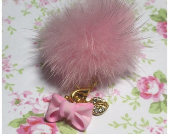 Bow with detachable fluffy