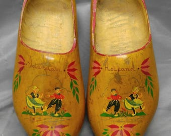 Old vintage pair of handmade hand painted wooden clogs wood shoes Holland Netherlands Dutch
