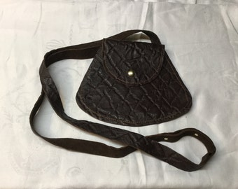 Embossed cross body leather bag