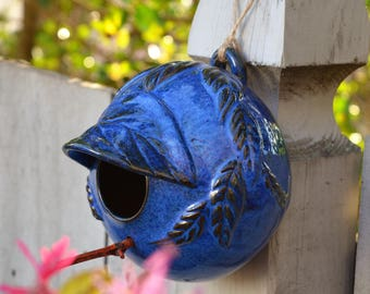 Hand thrown pottery bird house in beautiful blue glazes on dark clay - Hand carved and altered with leaf design