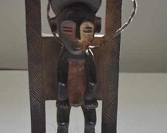 Two-faced hanging man african figure