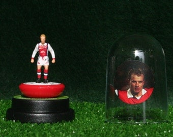 Dennis Bergkamp (Arsenal) - Hand-painted Subbuteo figure housed in plastic dome.