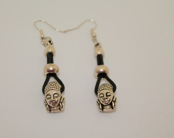 Black leather earrings with a tribal charm pendant