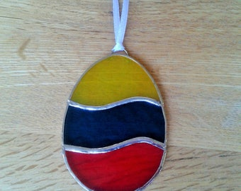 Stained Glass  Easter Egg Suncatcher made with red, yellow and blue glass. Easter gift, Easter decoration.