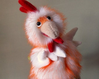 Cockerel. Toy on hand. Bibabo. Toy glove. Puppet theatre. Marionette.