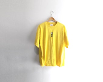yellow nike t shirt