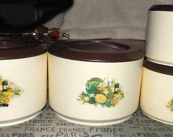 SET of 4 vintage (c.1970s) Sterilite canisters.  Images of fruit and vegetables, brown lids.