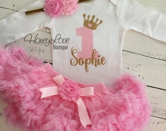Personalized 1st Birthday outfit, one number 1 tiara crown princess gold glitter shirt bodysuit, light pink tutu skirt, flower headband set