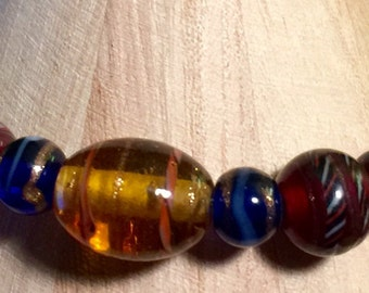 Colorful glass beads with gold swirls bracelet