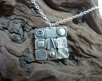 Silver patchwork pendant