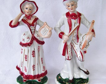 Matching Pair of Hand Painted Porcelain Colonial Figurines with Instruments