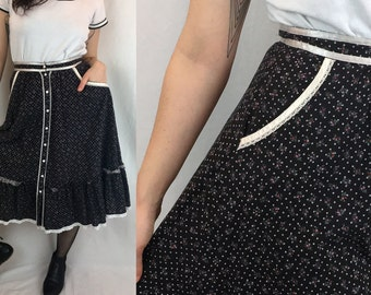 1970s Prairie Skirt | Black Floral Calico Hippie Ruffled Circle Skirt with Ribbon and Lace Trim & Pockets | Jessica's Gunnies