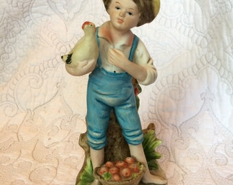 Vintage Homco 8880 Boy with Chicken - Standing in grass with bushel of apples - Blue overalls straw hat