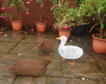 White duck wire sculpture. Ornament. Sculpture. Garden. Outdoor. Duck. Bird. Garden decor. Garden ornament. Ornament. Garden art. Outdoor
