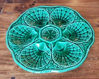 Fabulous French Oyster Platter made in Sarreguemines, France. Antique Majolica Porcelain, in glossy green glaze. Excellent condition.