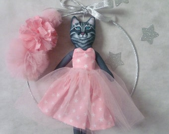 Cat in a tutu and her pink tulle PomPoms