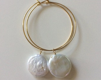 Gold plated hoops with coin pearl dangle.