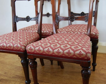 Antique upholstered, beautifully carved Victorian mahogany bar back dining chairs, set of four