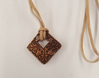 Embossed Ceramic Pendant Necklace - Leather Cord - Feng Shui Jewelry