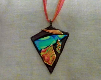 Extremely radiant red fused and dichroic glass pendant