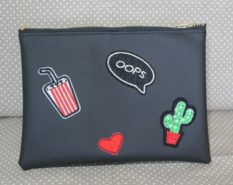 Faux leather clutch with applications