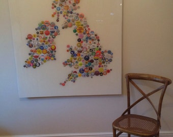 A picture of Great Britain made with vintage badges and covered with an acrylic resin