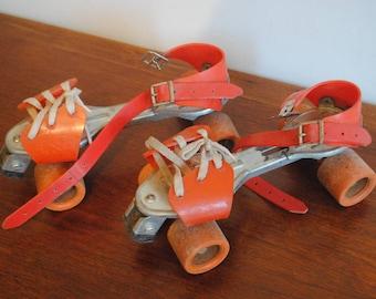 roulette metal plastic orange rollerskate-skates