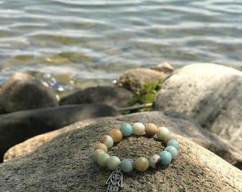 Multicolor beaded bracelet with hamsa charm