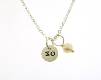 XO charm necklace, hugs and kisses dainty necklace, hand stamped disc charm with a white pearl by Kathryn Riechert