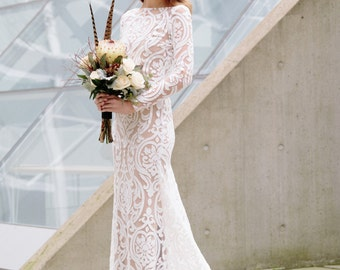 Santorini Gown | Stretch Lace Wedding Gown with Long Sleeves, Sheer Back, Sheath Skirt, and Full Circle Cathedral Train. Boho Wedding Chic!