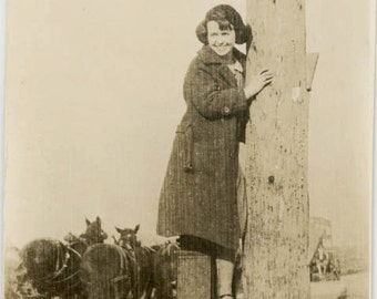 vintage photo Young Lady Climbs Telephone Pole