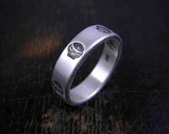 Made to order 6mm wide sterling silver band with purified skull stamps
