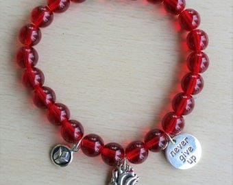 Red Czech glass with sterling anatomical heart charms
