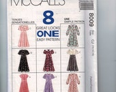 Childs Sewing Pattern McCalls 8009 Girls Modest Prairie Dress Button Front Collar Flutter Puff Sleeve Size 10 12 14 Breast 28 29 30 32 UNCUT