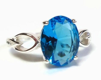 925 SF Silver Blue Topaz CZ Ring with Prong Set Crystal Center & Clear Crystal Accents - Vintage 70's Cubic Zirconia Costume Jewelry