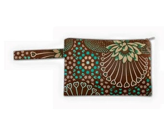 Ethnic, african print zipper pouch with side handle.