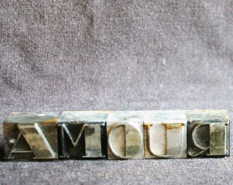 AMOUR. Vintage printing blocks. Antique rescued letterpress printer supply letters.
