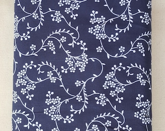 "Navy Blue with white floral print, 108"" wide back 100% cotton fabric"