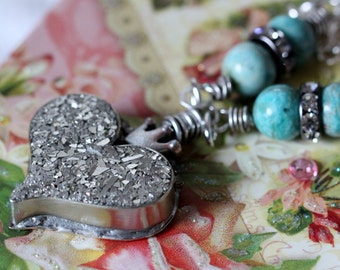 LOVE, hand forged heart, resin and glass glitter filled, sterling wire wrapped. boho pendant, crown, princess pendant